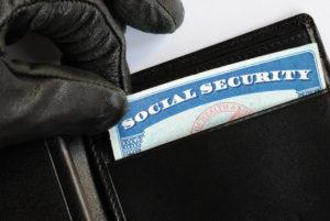 A thief stealing a social security card.