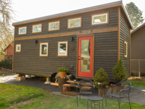 A hikari box tiny house with a modern exterior.