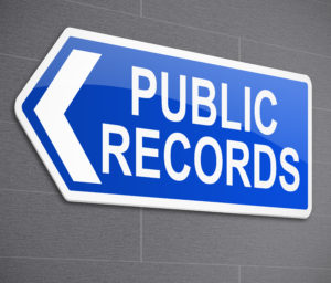 A sign talking about public records to help you when selling your home.