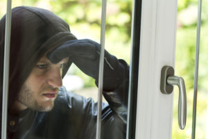 A burglar looking into your home!