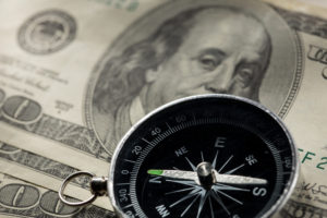 Navigating your down payment options with a compass