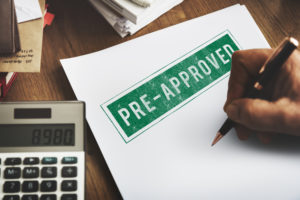 A pre-approved mortgage home loan being signed.