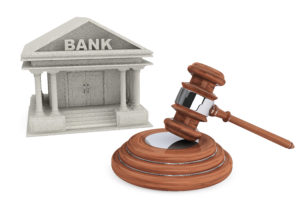 A picture of a bank with a gavel in front of it.