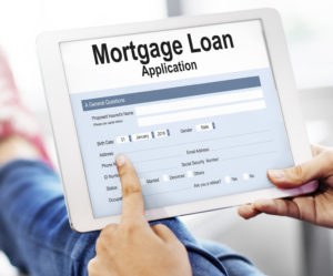 A person filling out a mortgage loan application online.