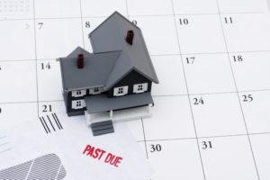 A house on a past due calendar symbolizing mortgage delinquencies.